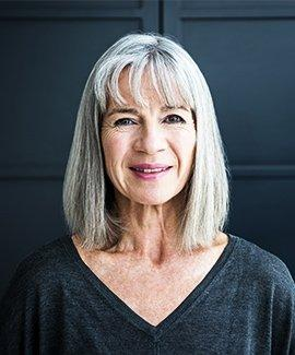 A head shot of a middle aged woman