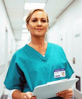 A female physician with a clipboard